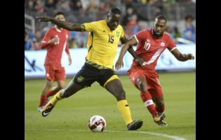 Je-Vaughn Watson (left) in action for Jamaica during a friendly match against Canada in September 2017.