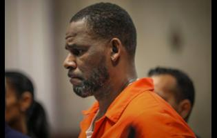 FILE - In this September 17, 2019, file photo, R. Kelly appears during a hearing at the Leighton Criminal Courthouse in Chicago. He was convicted Monday in a sex trafficking trial after decades of avoiding criminal responsibility for numerous allegations of misconduct with young women and children.