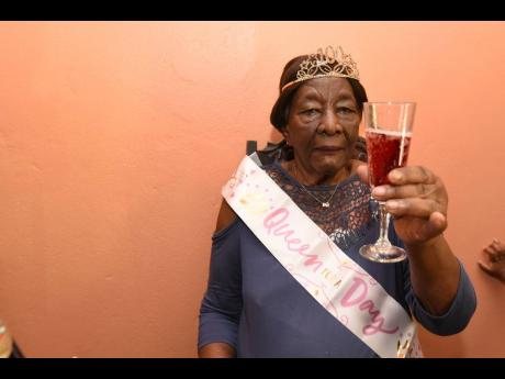 Cheers to 100 years! Centenarian Mercella Pearson celebrates her birthday with loved ones at her home in St Catherine.